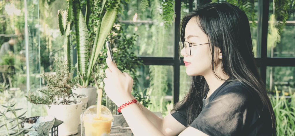 Asian female accessing Peace River Center telehealth