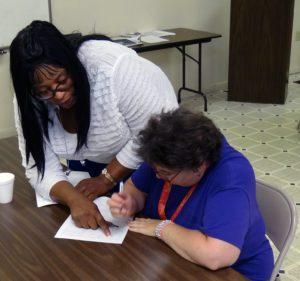 Ms. Rachel helping a client at Psychosocial Rehabilitation Services (PSR)