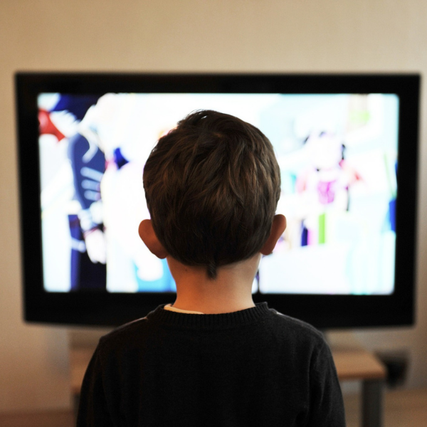 media consumption little boy in front of tv