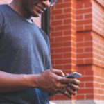 African American male on cell phone