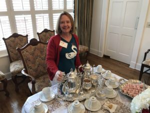 Susan Curry with silver service at Coffee Benefit