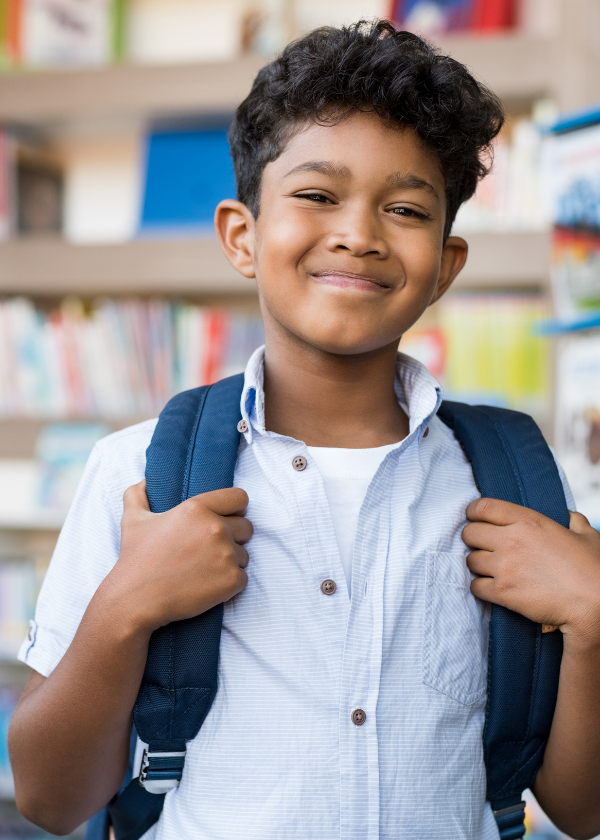 ethnic student with backpack smiling