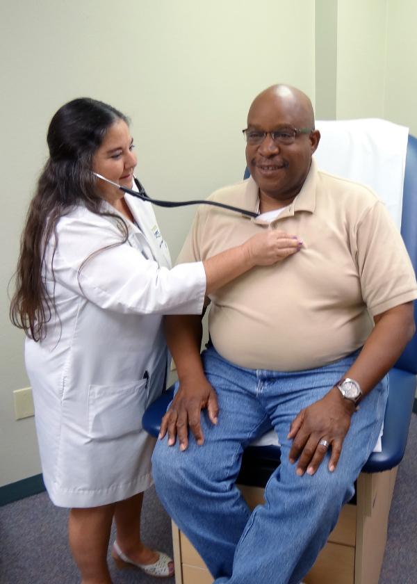 Dr. Mavra Kear examines a mock patient at PRC's Wellness Clinic