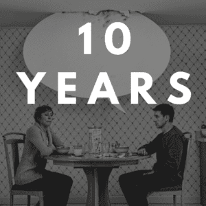 couple at table with empty speech bubble and 10 years above their heads