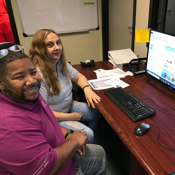 Club Success Assistant Director Deonte with clubhouse member Mary working in media unit