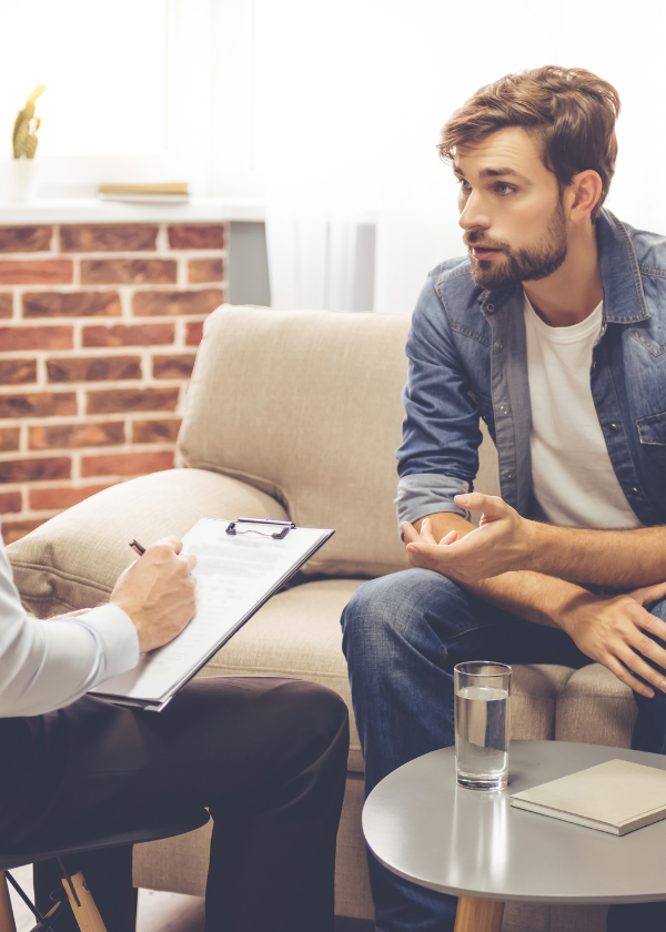 man in counseling session with male therapist
