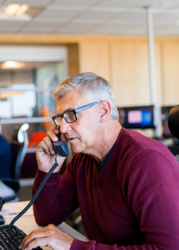 man on phone at desk in office setting