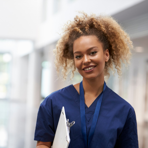blog feature image nurse in dark blue smiling