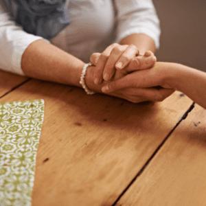 understanding holding hand in support