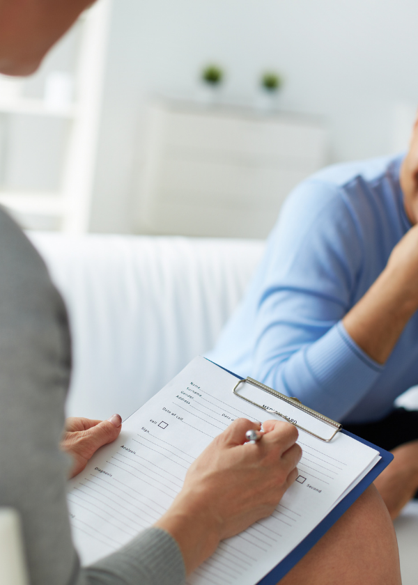 woman completing client's paperwork