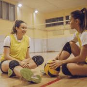 girls in volleyball uniform