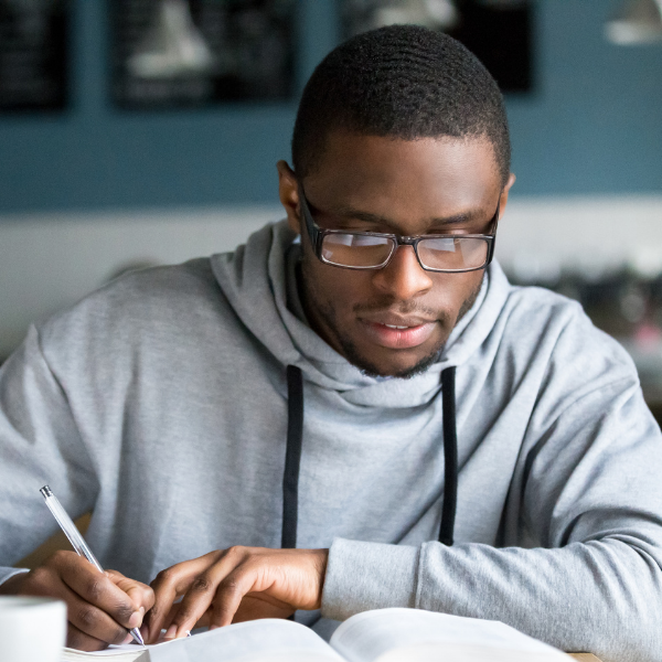 student with glasses studying